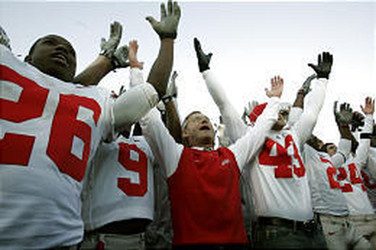 Ohio State coach Jim Tressel and team celebrate after defeating rival Michigan Saturday in Ann Arbor, Mich.
