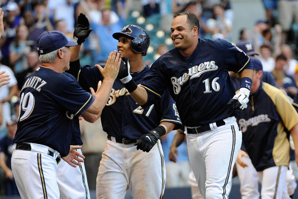 July 3, 2012; Milwaukee, WI, USA;  Milwaukee Brewers third baseman Aramis Ramirez (16) celebrates hitting a 2-run home run in the 10th inning to beat  the Miami Marlins 13-12 at Miller Park. Mandatory Credit: Benny Sieu-US PRESSWIRE