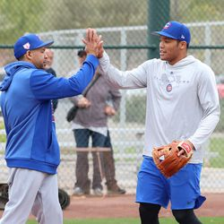 Juan Cabreja and Addison Russell high five after infield practice at Riverview Park, the Spring Training home of the Chicago Cubs in Mesa, AZ.  | John Antonoff/For the Sun-Times