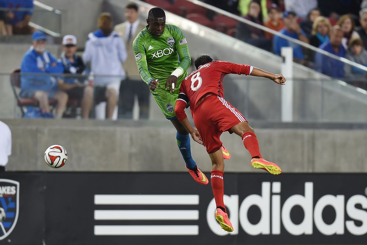 Anibaba fouls Wondolowski challenging for an aerial ball.
