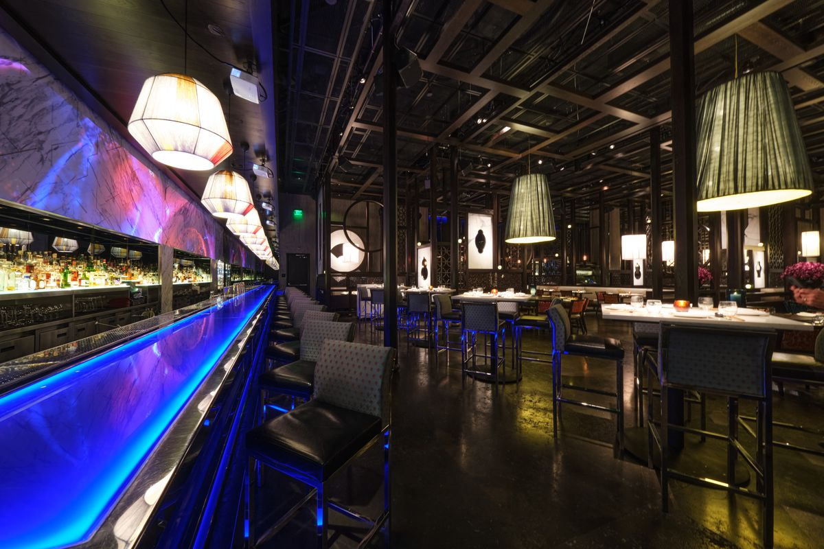 A bar with blue neon lighting