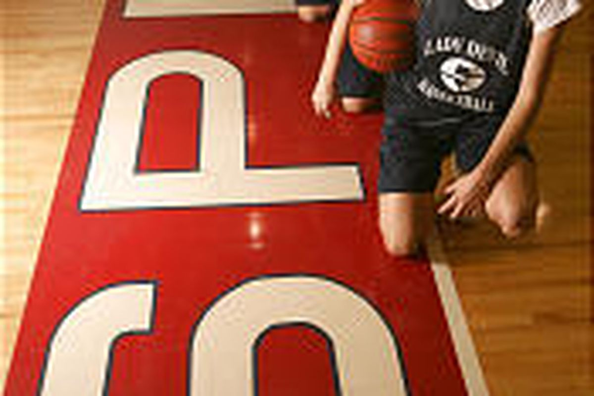 Springville High School girls basketball stars Nicole Morin, left, Macall Radford, center, and Cori Nielson on the court.