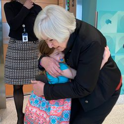 Gail Miller hugs Nellie Mainor, 9, who had a kidney transplant for dense deposit kidney disease and wanted to show Gail Miller around the dialysis clinic at Primary Children's Hospital in Salt Lake City after a press conference on Jan. 21, 2020. During the press conference, Intermountain Healthcare announced it will build an additional Primary Children's Hospital campus in Lehi. Gail Miller and the Miller family donated $50 million to the cause.