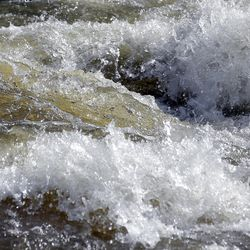 Fast-flowing water races down the Weber River in Oakley, Summit County, on Wednesday, May 31, 2017. Authorities in Utah are ratcheting up warnings telling people to stay away from the raging, icy waterways that are extremely dangerous this spring due to a snowy winter and wet spring.