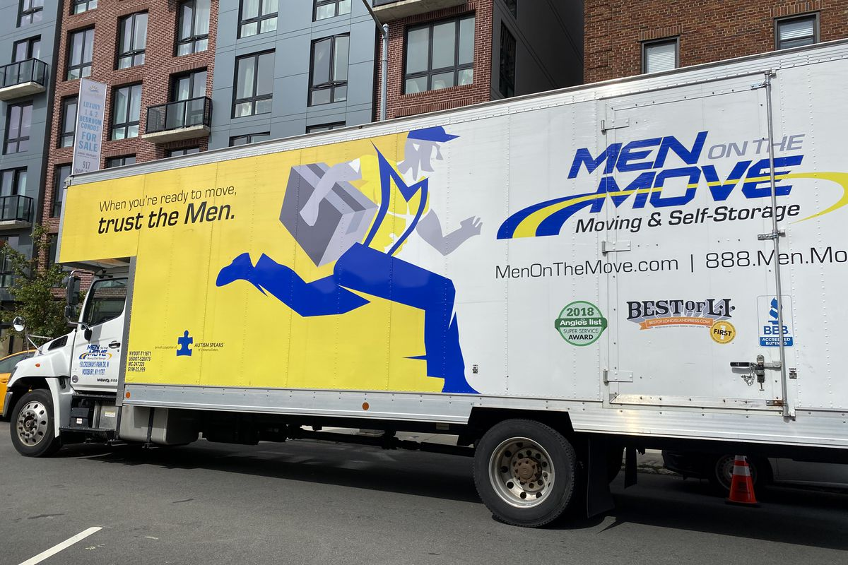 Men on the Move, moving truck outside apartment building, Queens, New York