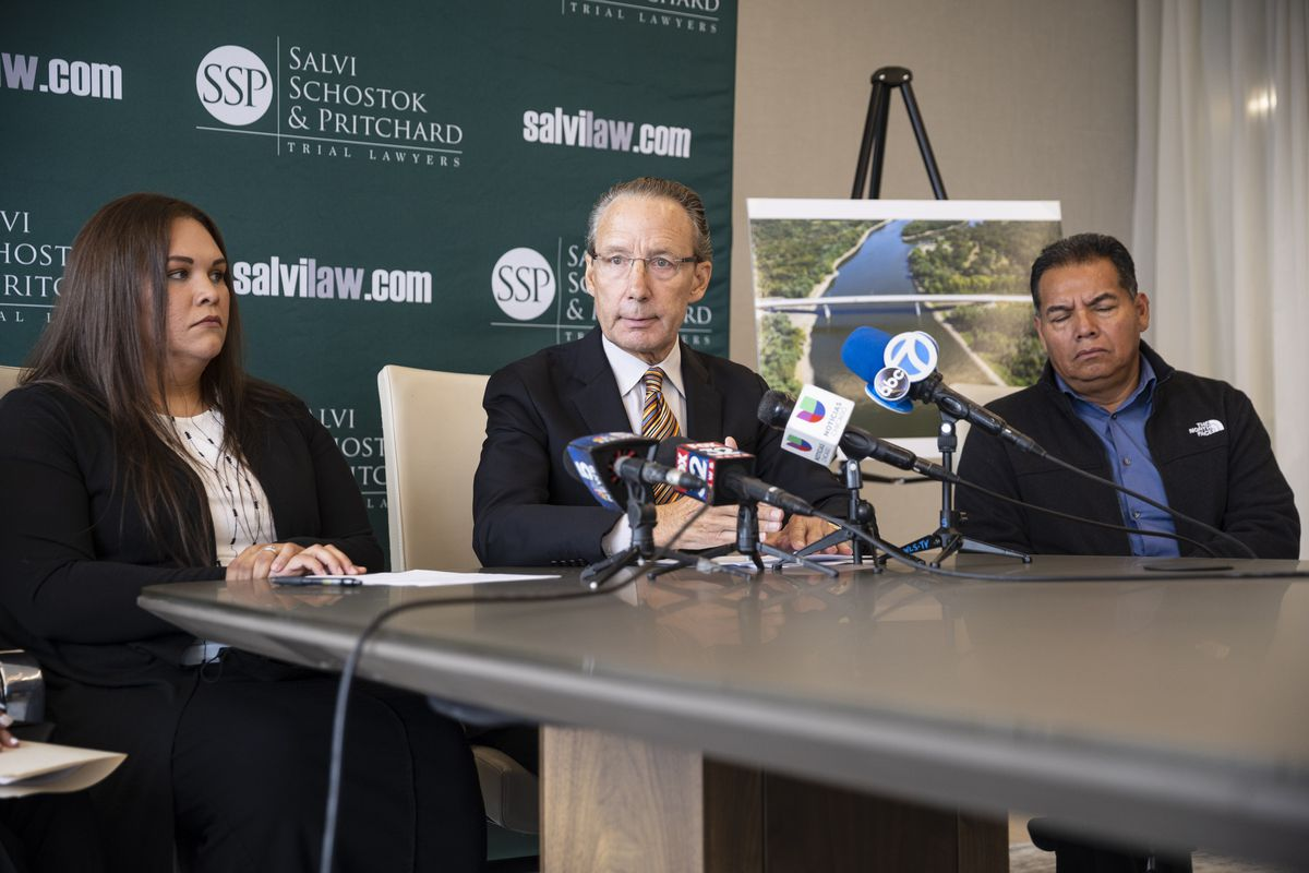 Attorney Patrick A. Salvi, center, listens to a question Thursday, Sept. 23, 2021, after discussing a lawsuit against construction and demolition companies over the deaths of Immer Rivera Tejada, 39, Rafael Rivera Tejada, 36, and their nephew Guillermo Rivera Tejada, 26.