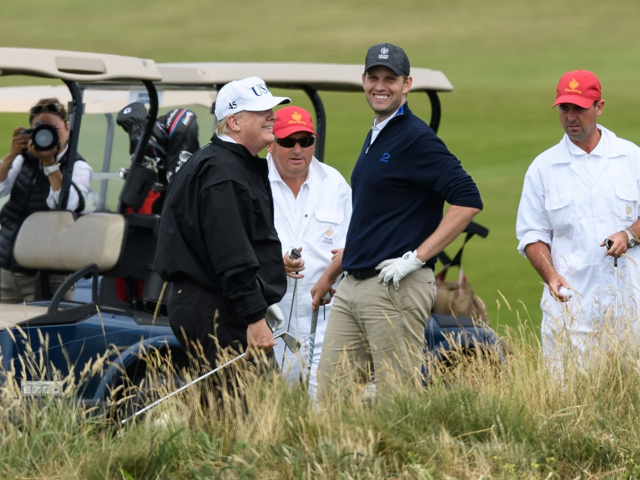President Donald Trump and his son, Eric Trump, on the golf course in July 2018.