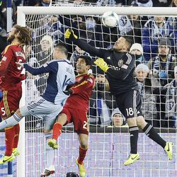 Real 'keeper Nick Rimando punches the ball away as Real Salt Lake and Sporting KC play Saturday, Dec. 7, 2013 in MLS Cup action. Sporting KC won in a shootout.