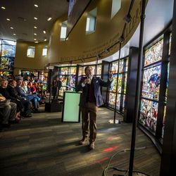 """Artist Tom Holdman speaks after the unveiling of the """"Roots of Knowledge"""" in the Fulton Library on the Utah Valley University campus in Orem on Friday, Nov. 18, 2016."""