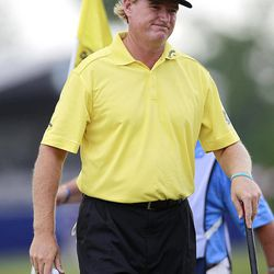 Ernie Els smiles as he walks off the ninth green during the final round of the Zurich Classic golf tournament at TPC Louisiana in Avondale, La., Sunday, April 29, 2012.