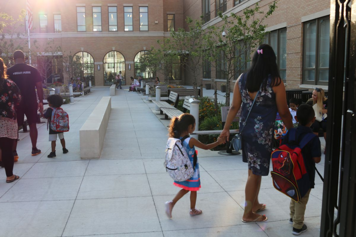 Parents drop students off to school on the first day of the 2018-2019 school year.