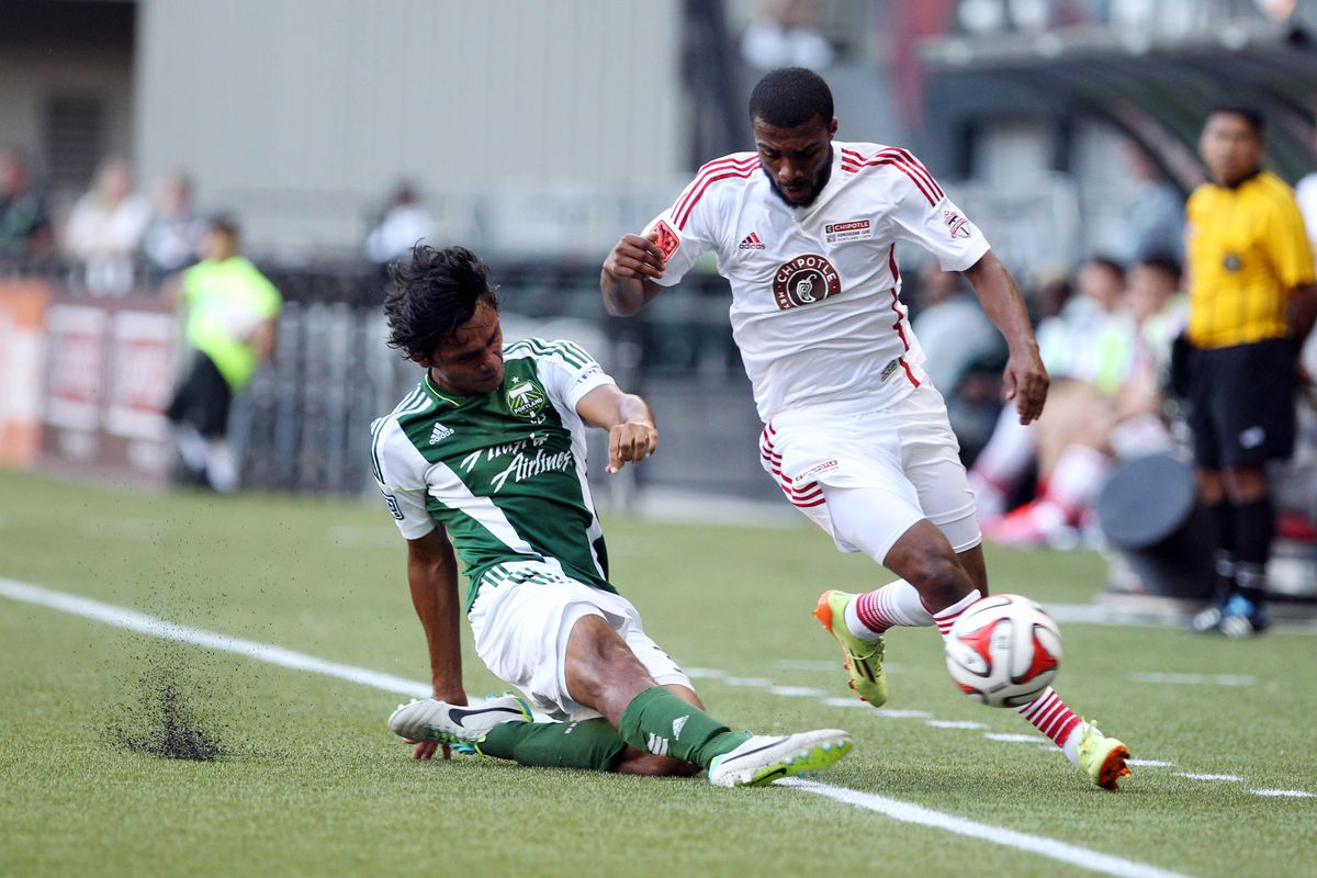 Castillo slides to knocks the ball away during the 2014 Chipotle Homegrown Game at Providence Park.