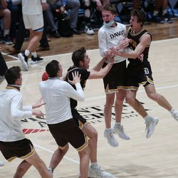 Davis players celebrate their win over Westlake during the 6A boys basketball championship game at Salt Lake Community College in Taylorsville on Saturday, March 6, 2021. Davis won 60-55.