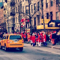 """Santas stumbling into Little Town NYC. Via <a href=""""http://instagram.com/p/TRBmKWmOtA/"""">Instagram/Icarusleung</a>."""