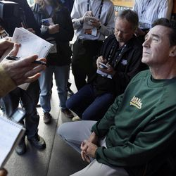 Oakland Athletics manager Bob Melvin talks with reporters in the dugout about roster moves before an exhibition baseball game against the San Francisco Giants in San Francisco, Wednesday, April 4, 2012.