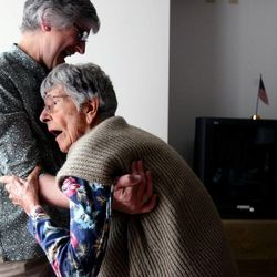 Jane Willie steadies her mother, Ellie Pasimeni, as she rises from her wheelchair in her room at St. Joseph's Villa in Salt Lake City in 2008.