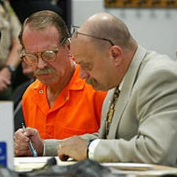 Ron Lafferty, left, and attorney Ron Yengich review documents naming Yengich as Lafferty's attorney on Sept. 25, 2002, in 4th District Court in Provo.