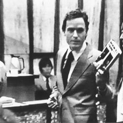 Theodore Bundy turns from the bench to face the media, watching from a television monitor in a press room, to criticize its coverge of his double murder trial in the Dade County courtroom in Miami, Fla., on July 31, 1979.  Bundy was making a last statement to the court before judge Edward C. Cowart sentenced him to die in the electric chair for the murders of two Florida State University sorority sisters.