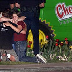 PJ Berg and Whitney Berg grieve outside the Chevys in Sandy after Quinn Martinez killed their father. The family had been celebrating PJ's 17th birthday.