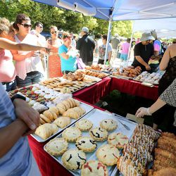 Shoppers look at pastries on the opening day of the farmers market Saturday, June 13, 2015, in Salt Lake City at Pioneer Park.