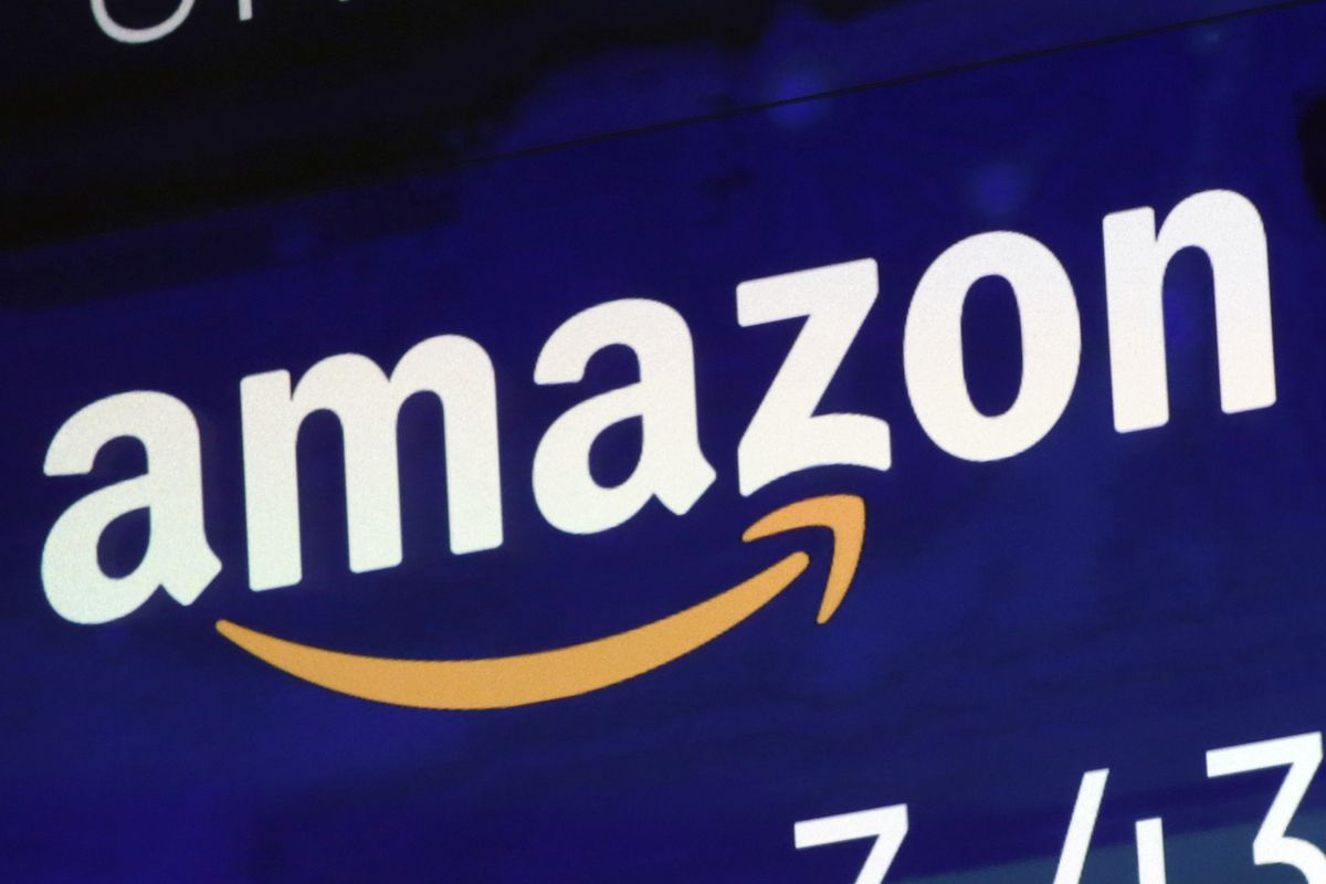 In this July 27 file photo, the logo for Amazon is displayed on a screen at the Nasdaq MarketSite in New York. Amazon is boosting its minimum wage for all U.S. workers to $15 per hour starting next month. The company said Tuesday, Oct. 2, that the wage hi