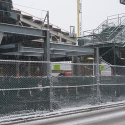 Tighter view of the work taking place in the gap between the right field grandstand and the bleachers