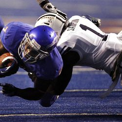 D.J. Harper (7) of the Boise State Broncos dives for yardage against Joe Sampson (1) of the Brigham Young Cougars sduring NCAA football in Boise, Thursday, Sept. 20, 2012.