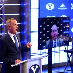 BYU athletic director Tom Holmoe speaks at a press conference where the school announced it accepted an invitation to join the Big 12 Conference in Provo on Friday, Sept. 10, 2021. At right, Big 12 commissioner Bob Bowlsby joins via video conference. BYU will play all sports provided by the Big 12 except for equestrian, rowing and wrestling. Men's volleyball will continue to play in the Mountain Pacific Sports Federation, as the Big 12 does not offer the sport.