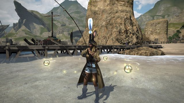 An exclamation point appears over the head of a rabbit-eared woman fishing in Final Fantasy 14