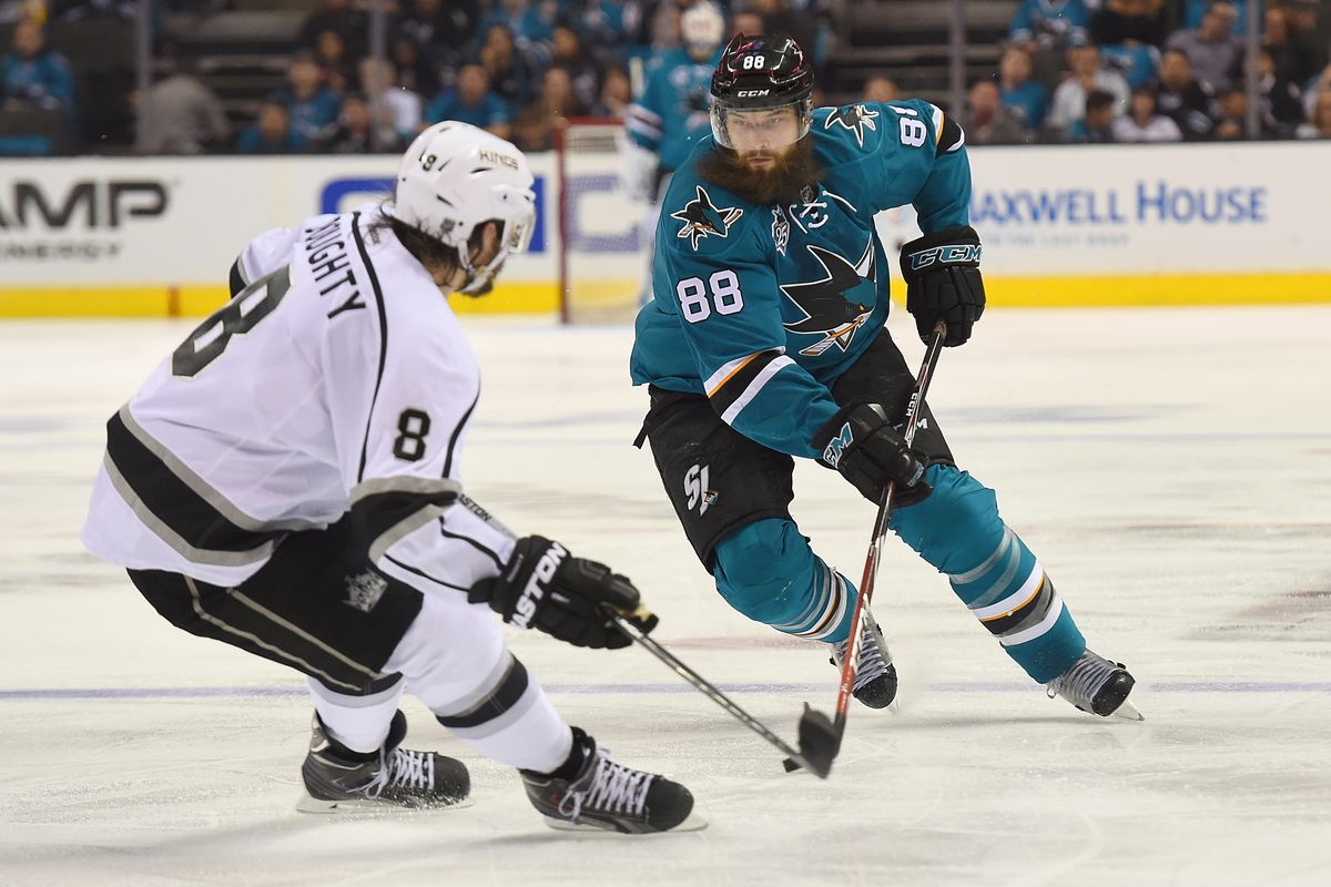 Brent Burns of the San Jose Sharks controling the puck, looks to skate past Drew Doughty of the Los Angeles Kings in the second period in Game 3 of the Western Conference First Round during the 2016 NHL Stanley Cup Playoffs