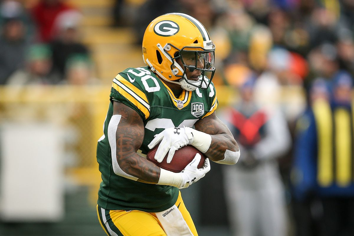 Green Bay Packers running back Jamaal Williams runs with the ball in the first quarter against the Detroit Lions at Lambeau Field on December 30, 2018 in Green Bay, Wisconsin.