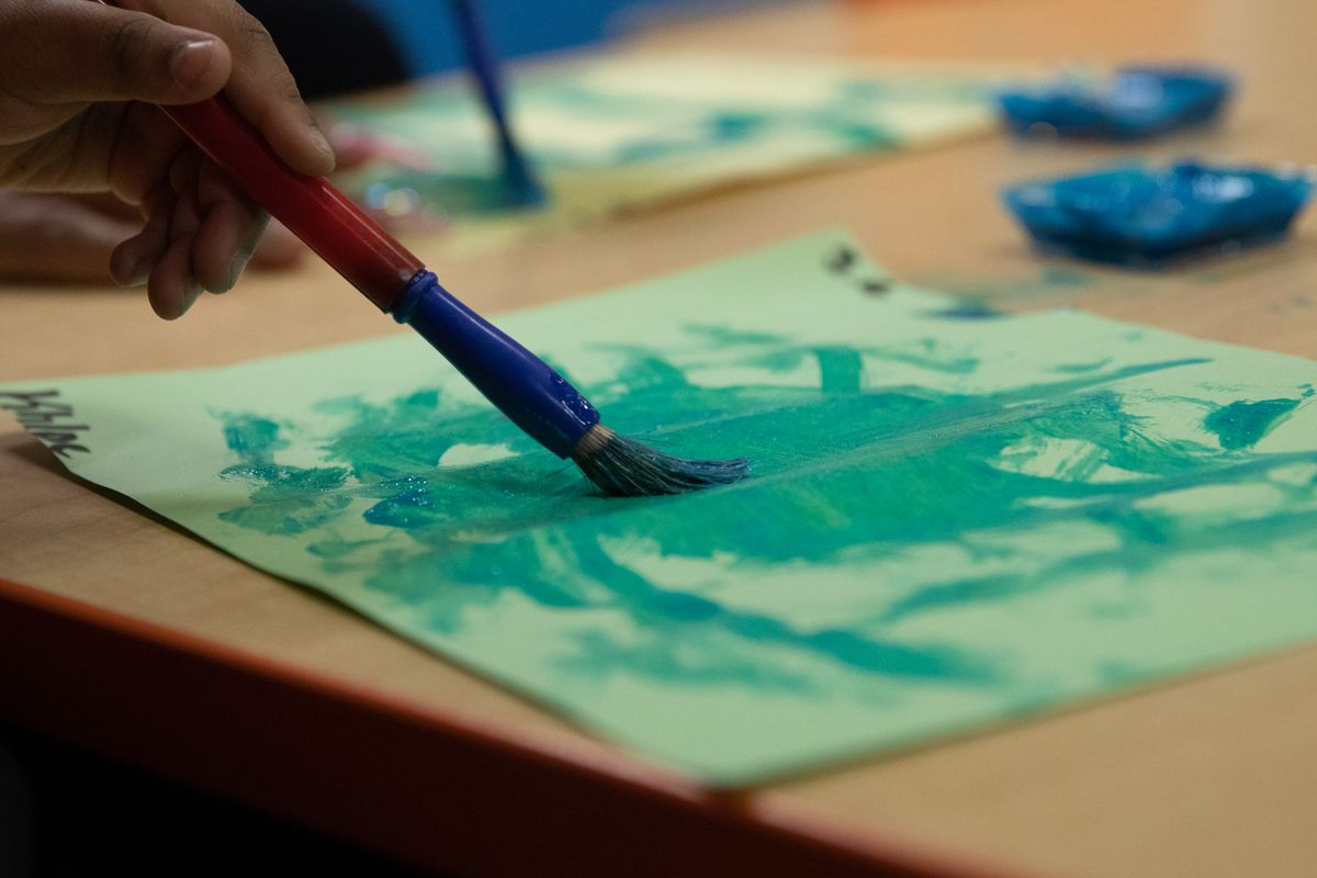 Preschoolers participate in a painting activity at Little Scholars child care center in Detroit, Michigan, U.S., on Thursday April 1, 2021.