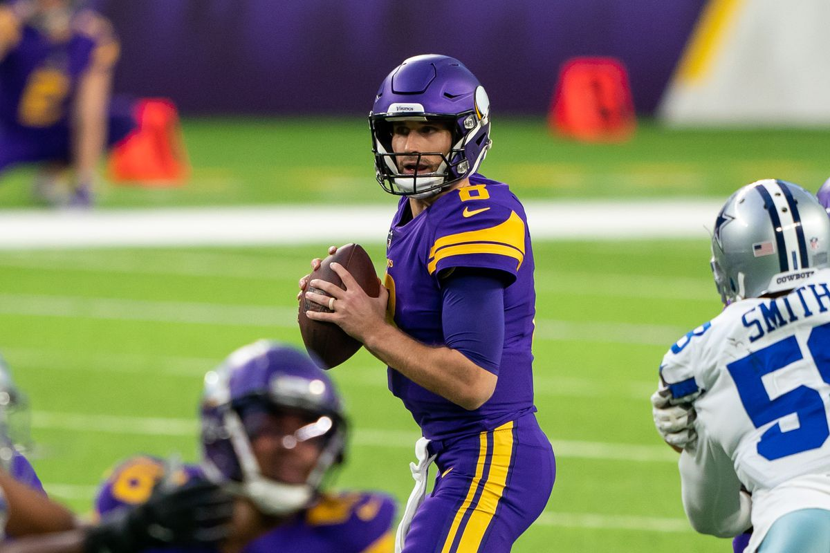 Minnesota Vikings quarterback Kirk Cousins (8) drops back to pass against the Dallas Cowboys in the first quarter at U.S. Bank Stadium.