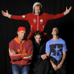 In this March 16, 2012 photo, members of the Red Hot Chili Peppers, clockwise from top, bassist Flea, singer Anthony Kiedis, guitarist Josh Klinghoffer and drummer Chad Smith pose for a portrait in the Hollywood section of Los Angeles. The group will be inducted into the Rock and Rock Hall of Fame on Saturday, April 14.