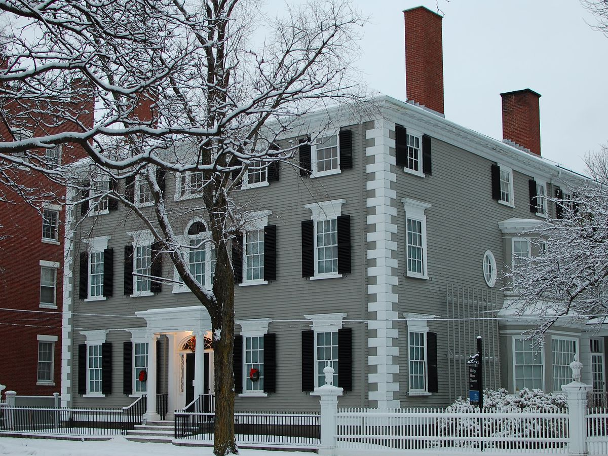 An elegant federal-style house with four chimneys.