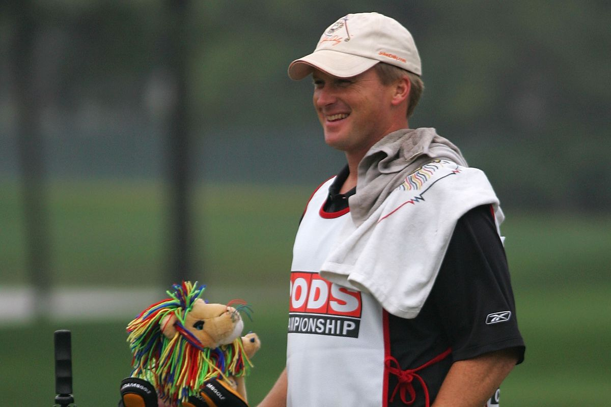 Head coach Jon Gruden of the Tampa Bay Buccaneers caddies for John Daly during the first round of the PODS Championship at Innisbrook Resort and Golf Club on March 6, 2008 in Tarpon Springs, Florida.