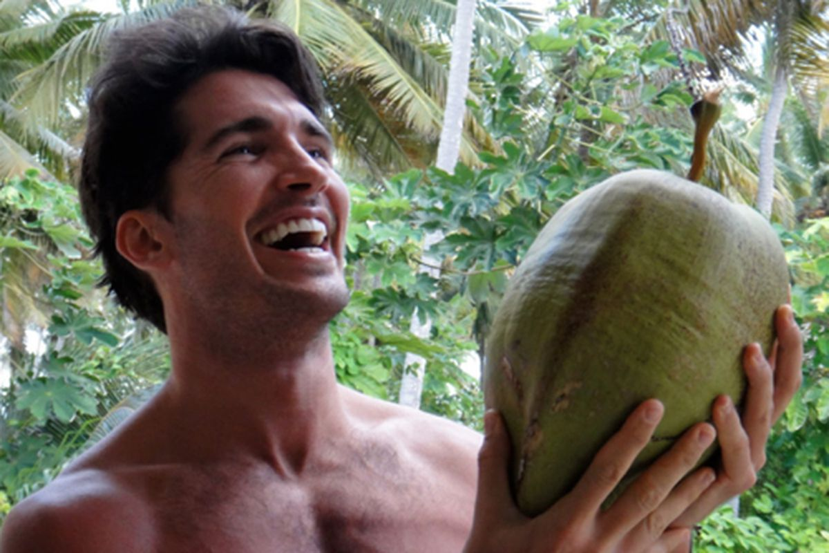 """Model, raw food eater and gardener Anthony Anderson and a coconut. Photo via <a href=""""http://thechalkboardmag.com/interview-with-raw-model-blogger-anthony-anderson"""">The Chalkboard</a>."""
