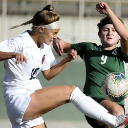 Brighton's Kendra Hassell (10) and Olympus' Emma Neff (9) compete during the 5A girls soccer state quarterfinals at Olympus High School in Holladay on Thursday, Oct. 15, 2020.