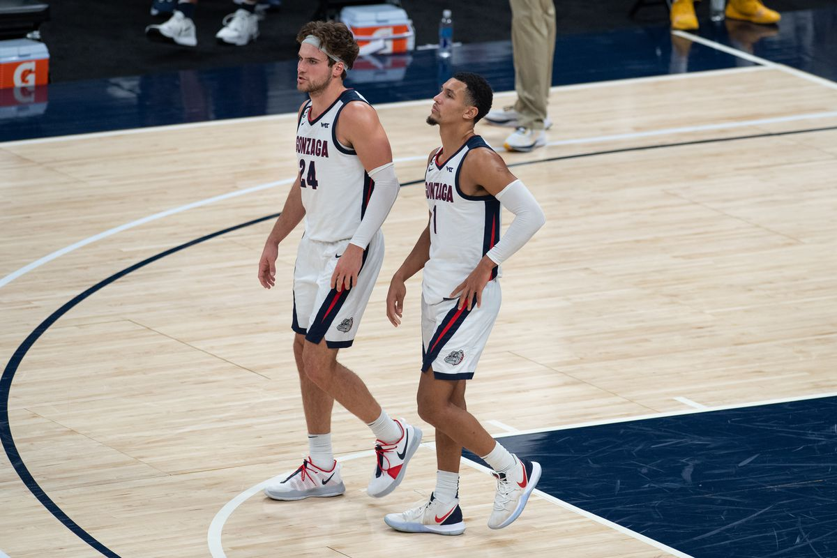 Gonzaga Bulldogs guard Jalen Suggs and Gonzaga Bulldogs forward Corey Kispert stand on the court during a free throw attempt during the men's Jimmy V Classic college basketball game between the Gonzaga Bulldogs and West Virginia Mountaineers on December 2, 2020, at Bankers Life Fieldhouse in Indianapolis, IN.
