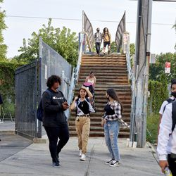 Students descend down a staircase as they make their way toward Pan American High School in Elmhurst for the first day of classes.
