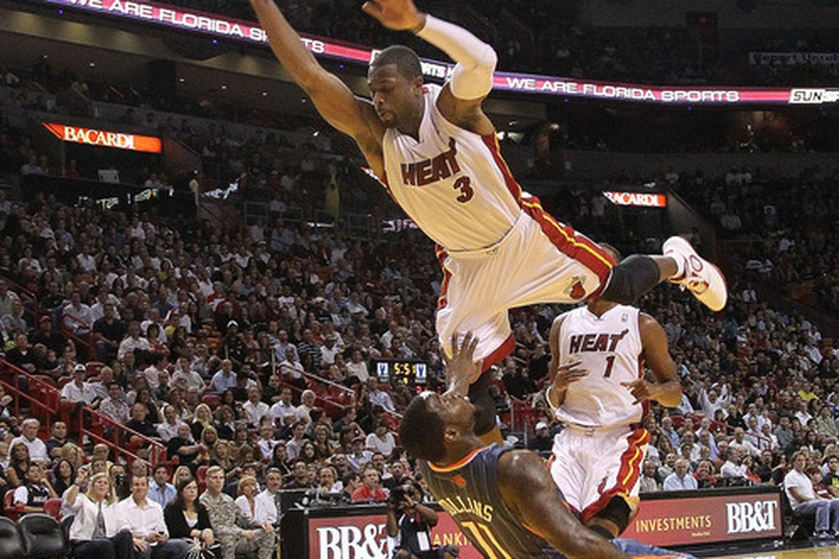 MIAMI - NOVEMBER 19: Dwyane Wade takes flight during a game against the Charlotte Bobcats at American Airlines Arena. (Photo by Mike Ehrmann/Getty Images)