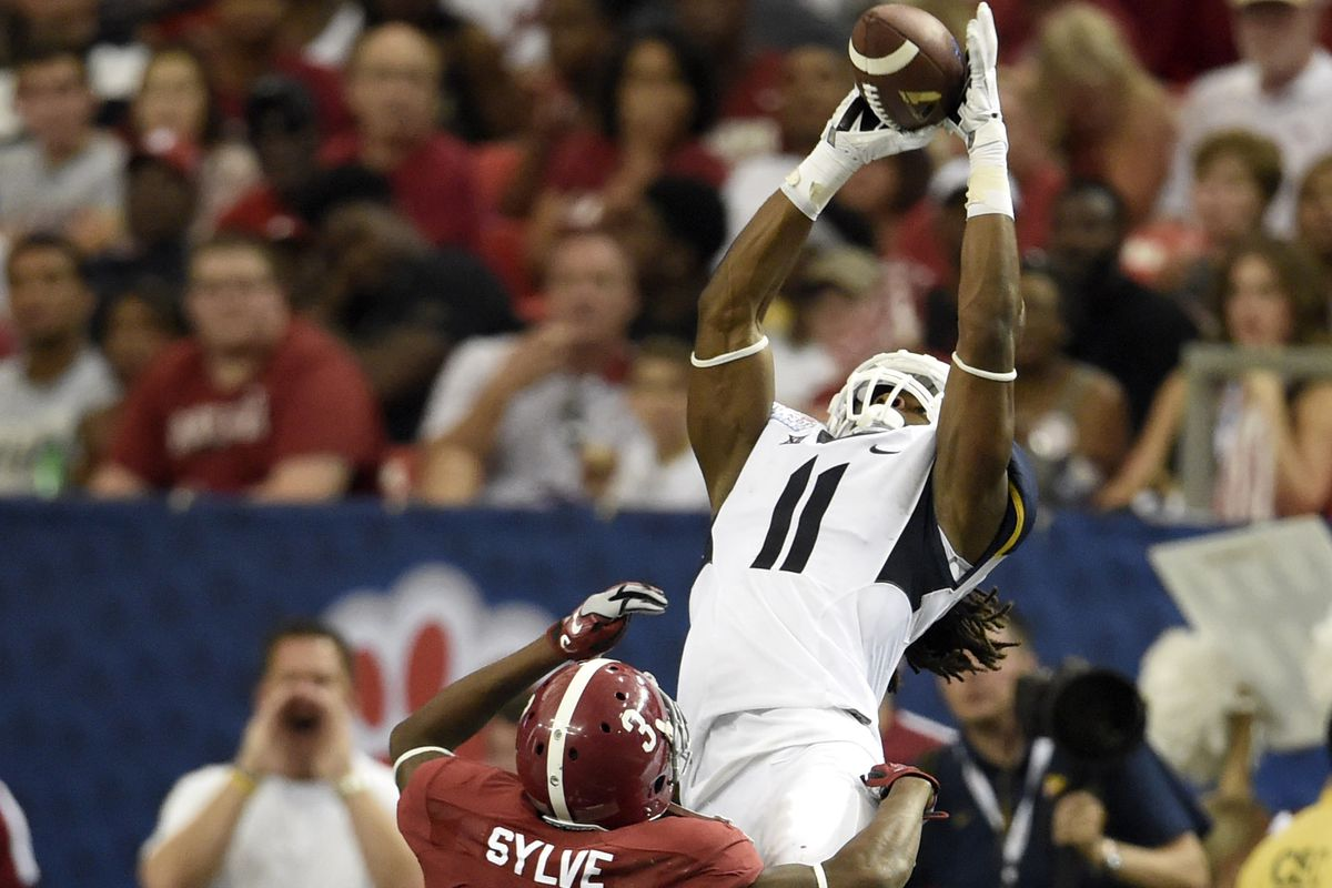 Kevin White catches a touchdown against Alabama in the 2014 Chick-fil-A Kickoff Game