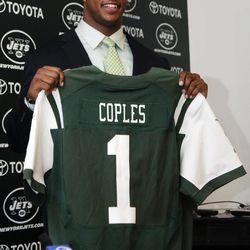 New York Jets first-round NFL football draft pick Quinton Coples smiles as he holds up a jersey while being introduced during a news conference, Friday, April 27, 2012, in Florham Park, N.J.