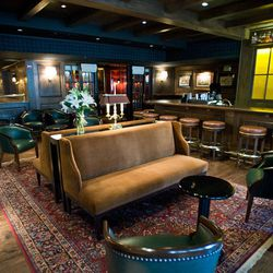 Pull up a suede couch in the lounge while awaiting your table