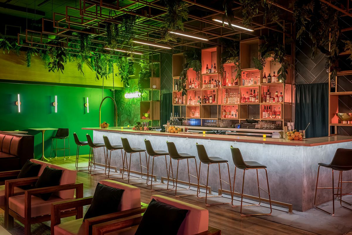 Bar area with green lights at Canary.