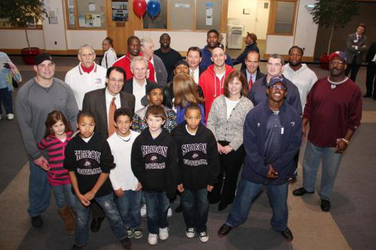 <em>Patriots players and staff distributed food baskets filled with turkeys and Thanksgiving fixings to over 200 families in need at Morgan Memorial Goodwill</em>.