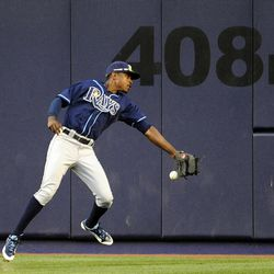 Tampa Bay Rays center fielder B.J. Upton misses a fly ball from New York Yankees' Robinson Cano in the eighth inning of a baseball game, Saturday, Sept. 15, 2012, at Yankee Stadium in New York. The Yankees won 5-3.