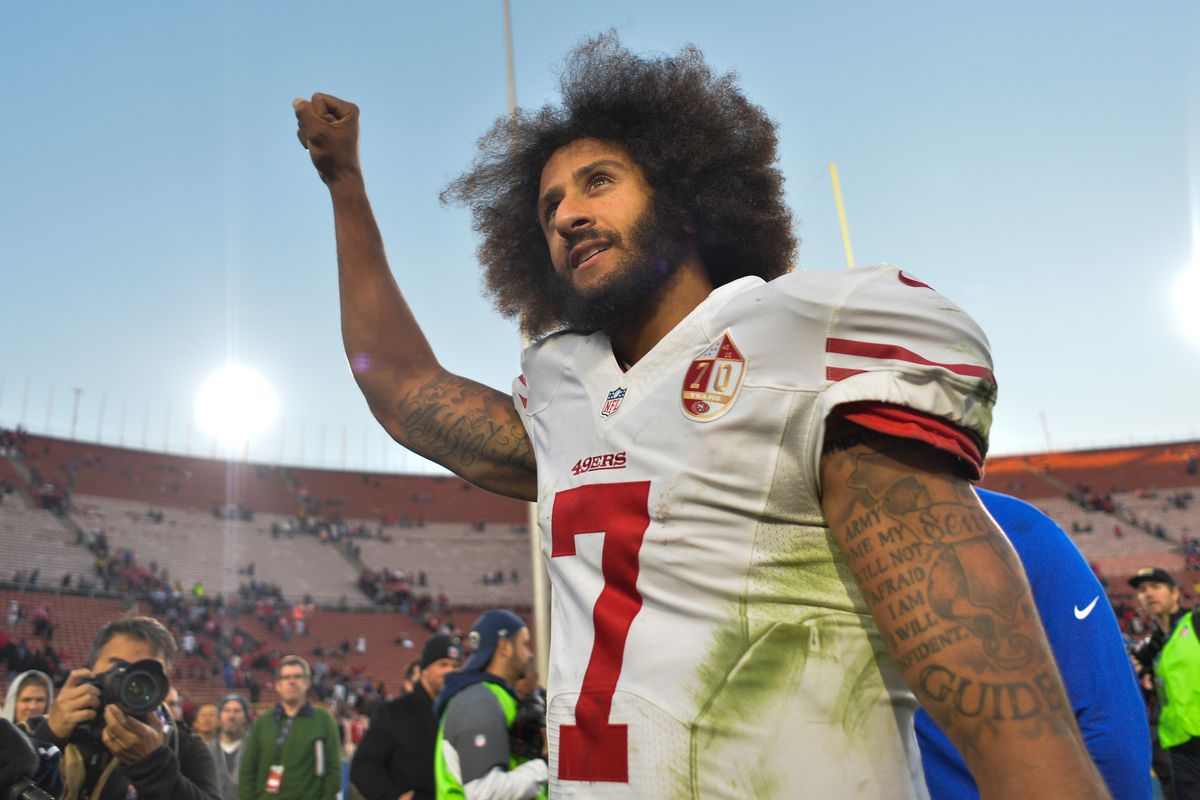 San Francisco 49ers quarterback Colin Kaepernick pumps his fist as he acknowledges the cheers from the 49ers' fans after leading his team to a 22-21 come-from-behind win over the Los Angeles Rams at Los Angeles Memorial Coliseum.