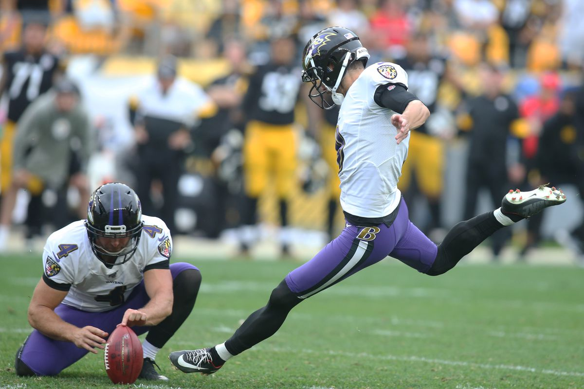 Baltimore Ravens kicker Justin Tucker kicks the game winning field goal from the hold of punter Sam Koch to defeat the Pittsburgh Steelers in overtime at Heinz Field