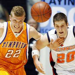 Timpviews' #22 Ky Raymond and Mountain Crest's #20 Matt Stewart battle for the ball as Mountain Crest and Timpview play in the 4A boys Basketball championship game.